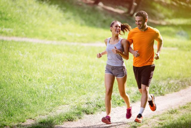 Man and woman jogging outside