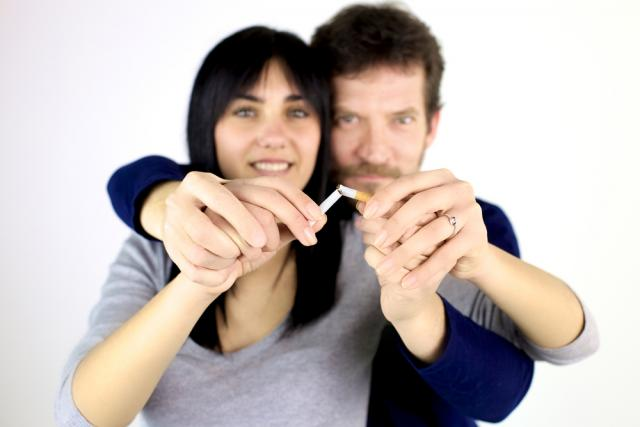 Man and woman breaking a cigarette together