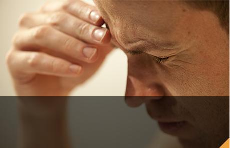 man suffering from a headache