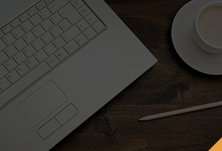 Laptop and a cup of coffee on a desk.